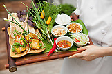 VIETNAM, Hanoi, Sofitel Metropole Hotel, chef Kim Hai holds a tray filled with lunch selections
