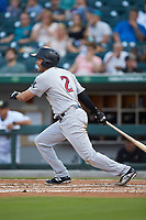 Breyvic Valera (2) of the Scranton/Wilkes-Barre RailRiders follows through on his swing against the Charlotte Knights at BB&T BallPark on August 14, 2019 in Charlotte, North Carolina. The Knights defeated the RailRiders 13-12 in ten innings. (Brian Westerholt/Four Seam Images)