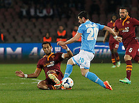 in action during the Italian Serie A soccer match between SSC Napoli and AS Roma   at San Paolo stadium in Naples, March 09 , 2014