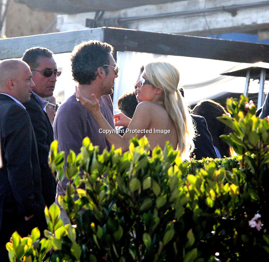 2011.July 3rd Exclusive ...Paris Hilton hugging & kissing director Todd Phillips at a beach house party in Malibu California.  Gerard Butler & Bradley Cooper also attended the pre-4th of July party ..AbilityFilms@yahoo.com.805-427-3519.www.AbilityFilms.com..