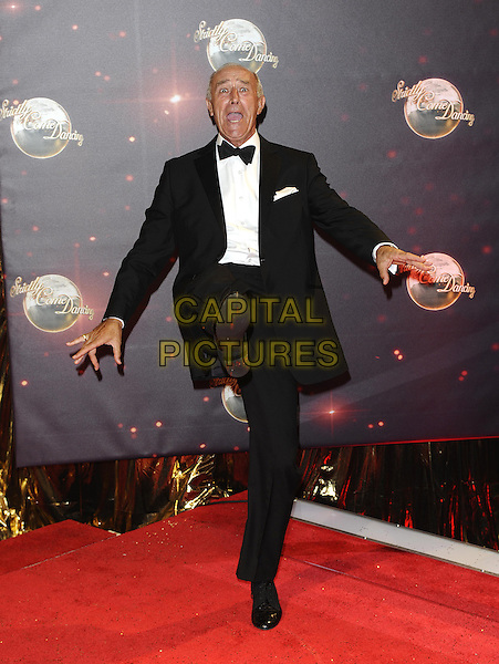 Len Goodman <br /> The red carpet launch for 'Strictly Come Dancing' at Elstree Studios, Borehamwood, England.<br /> September 3rd, 2013<br /> full length black tuxedo white shirt bow tie smiling kick kicking funny <br /> CAP/FIN<br /> &copy;Steve Finn/Capital Pictures