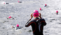 08 AUG 2010 - LONDON, GBR - A competitor watches  elite race at the  2010 Challenger World London Triathlon .(PHOTO (C) NIGEL FARROW)