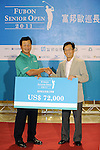 TAIPEI, TAIWAN - NOVEMBER 20:  Lu Chien Soon of Taiwan receives a cheque after winning the Fubon Senior Open at Miramar Golf & Country Club on November 20, 2011 in Taipei, Taiwan.  Photo by Victor Fraile / The Power of Sport Images