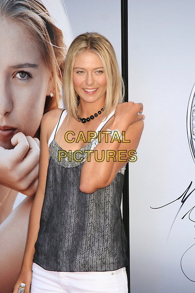 MARIA SHARAPOVA.Launches her new Tag Heuer Watch,.Fortunoff's, Nwy York City, 23rd August 2005.half length tennis player number 1 ranked endorsement product hand shoulder over white trousers grey gray strappy top poster advertisement.www.capitalpictures.com.sales@capitalpictures.com.©Capital Pictures