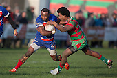 Lolohea Loco gets tackled by Akariva Niubalavu. Counties Manukau Premier Club Rugby game between Waiuku and Ardmore Marist, played at Waiuku on Saturday June 4th 2016. Ardmore Marist won 46 - 3 after leading 39 - 3 at Halftime. Photo by Richard Spranger.