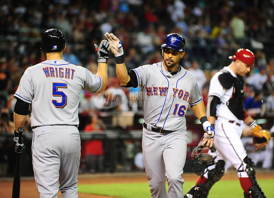 Jul. 20, 2010; Phoenix, AZ, USA; New York Mets outfielder (16) Angel Pagan is congratulated by teammate David Wright after hitting a solo home run in the ninth inning against the Arizona Diamondbacks at Chase Field. Arizona defeated New York 3-2. Mandatory Credit: Mark J. Rebilas-