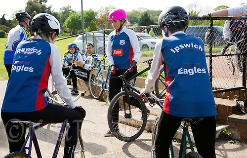 10 MAY 2015 - GREAT BLAKENHAM, GBR - Charlie-Jane Herbert (centre) of Ipswich Eagles Cycle Speedway Club steps back into the pits after a heat during the South East 2 League fixture against Great Blakenham at Great Blakenham, Suffolk, Great Britain (PHOTO COPYRIGHT © 2015 NIGEL FARROW, ALL RIGHTS RESERVED)