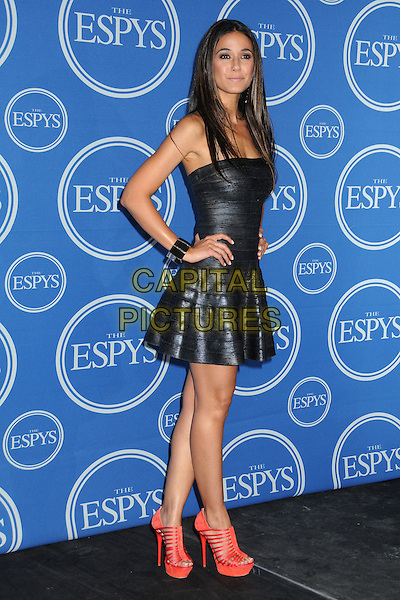 Emmanuelle Chriqui.2011 ESPY Awards - Press Room held at Nokia Theatre L.A. Live, Los Angeles, California, USA..July 13th, 2011.full length leather dress hands on hips red strappy platform shoes sandals strapless black smiling silver cuff side bracelet.CAP/ADM/BP.©Byron Purvis/AdMedia/Capital Pictures.
