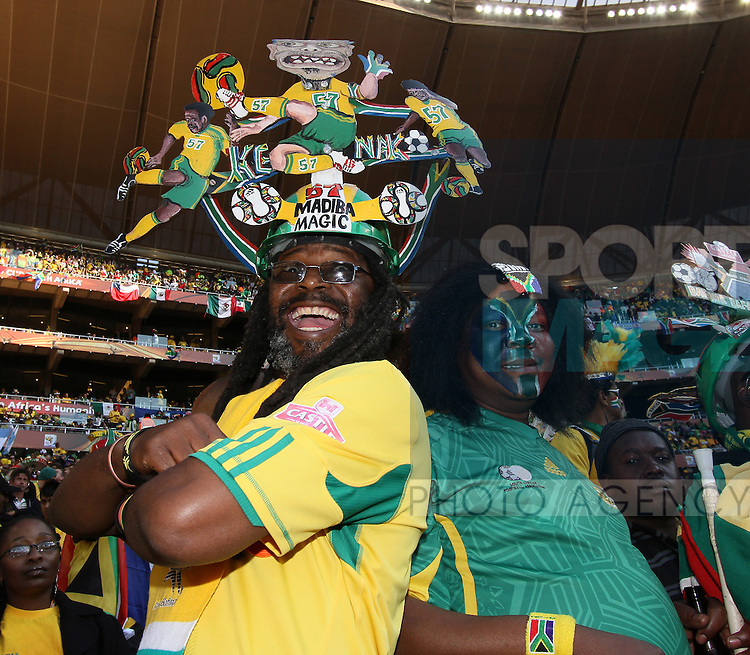 South African fans cheer their side on
