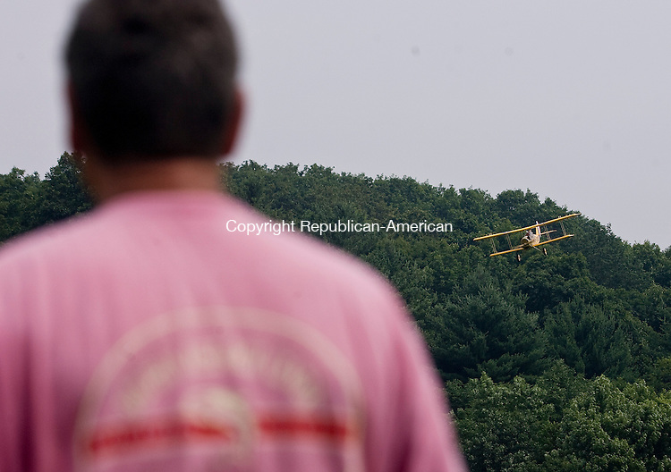 THOMASTON--19 July 08--071908TJ06 - Paul Moses maneuvers his Curtiss Jenny replica above the Leadmine Brook Area during the Nugmeg Flyers' Fun Fly at the Thomaston Dam on Saturday, July 19, 2008. (T.J. Kirkpatrick/Republican-American)