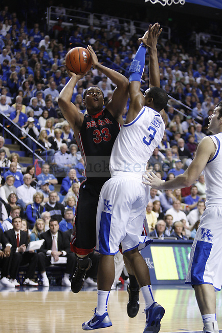 Georgia's Trey Tompkins attempts a field goal against freshman Terrence Jones during the second half of UK's home game against Georgia on Jan. 29, 2011. Photo by Brandon Goodwin | Staff