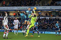 Adebayo Akinfenwa & Luke O'Nien of Wycombe Wanderers go up with Goalkeeper Glenn Morris of Crawley Town during the Sky Bet League 2 match between Wycombe Wanderers and Crawley Town at Adams Park, High Wycombe, England on 25 February 2017. Photo by Andy Rowland / PRiME Media Images.