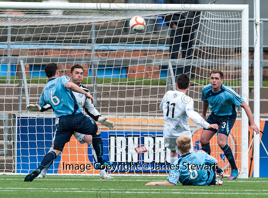 Ayr Utd's Michael Donald shoots over the bar from close range.