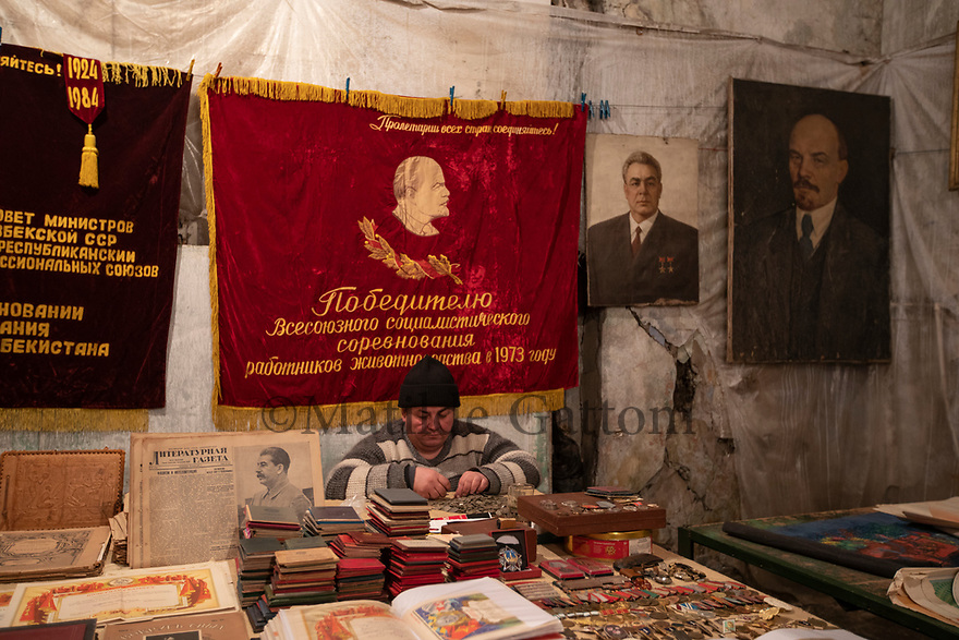 Uzbekistan - Tashkent - A flee market located next to a railway station in the Sergeli neighborhood. Several stalls sell old Soviet souvenirs and books.