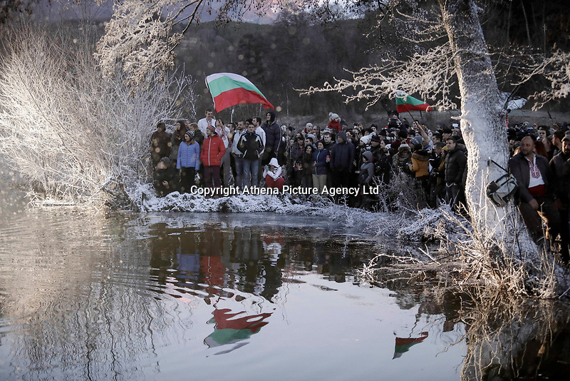 """Men perform the traditional Bulgarian """"Horo"""" dance, an Orthodoc Church tradition, in the icy waters of the Tundzha River in the village of Kalofer, 200 km east of Sofia, as part of the Epiphany Day celebrations in Bulgaria. Saturday 06 January 2018"""