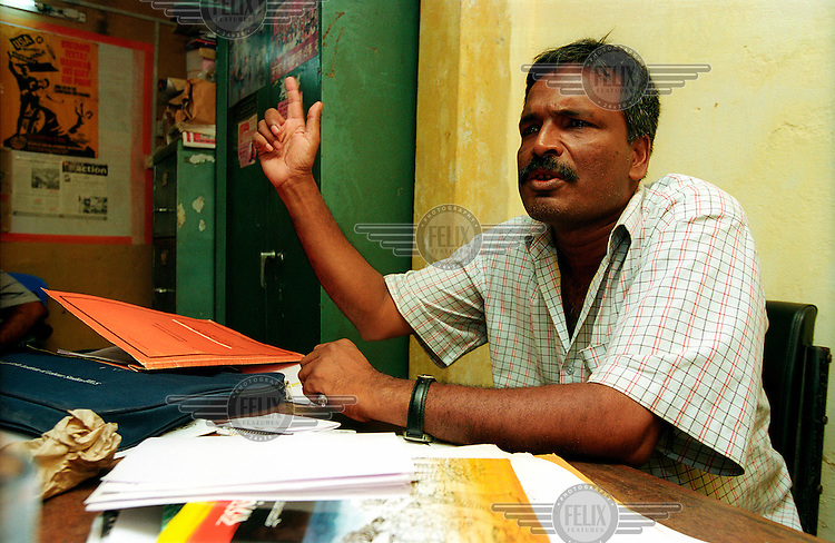 Mr Amin, secretary of the Garment Workers' Federation at his office in Dhaka. The garment industry accounts for four-fifths of Bangladesh's foreign revenues and employs about 1.8 million workers, mostly women and mostly low paid. Garment workers regularly die in industrial accidents and safety standards remain low by international standards.