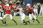 January 5th, 2008:  Rutgers defensive end Jamaal Westerman (90) pressures Ball State quarterback Nate Davis (13) as lineman Andre Ramsey (79) attempts to block in the third quarter of the International Bowl at the Rogers Centre in Toronto, Ontario Canada...Rutgers defeated Ball State 52-30.  ..Photo By:  Mike Janes Photography