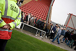 Fans of Crewe Alexandra filing out of the Alexandra Stadium after their teams' League 2 match against Aldershot Town. The visitors won by 2 goals to 1.