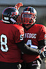 Plainedge quarterback No. 14 Davien Kuinlan, right, gets congratulated by No. 58 Brian Jockers after he ran for a touchdown in a Nassau County varsity football Conference III semifinal against Roosevelt at Hofstra University on Saturday, Nov. 14, 2015. He ran for four touchdowns in the first half to lead Plainedge to a 53-13 win.<br /> <br /> James Escher