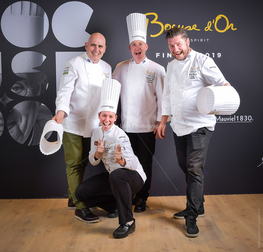 Lyon, 28 January 2019 – The Australian team of Michael Cole (Candidate), Laura Skvor (Commis), Scott Pickett (Coach), and Tom Milligan (President) pose for photographs prior to the 2019 Finale of the Bocuse d'Or held at the Sirha trade show at Eurexpo in Lyon, France. Photo Bocuse d'Or/Pool