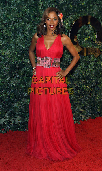 HOLLY ROBINSON PEETE.QVC  Celebrates Red Carpet Style At The Four Seasons Hotel  held at the Four Seasons, Beverly Hills, California, USA..March 5th, 2010.full length red maxi dress sleeveless hands on hips pink belt .CAP/ADM/TC.©T. Conrad/AdMedia/Capital Pictures.