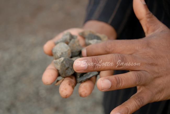 Agnes Mzobotshi holds stone mined from Mzintlava Quarries, in Lusikisiki in the Eastern Cape, which she owns together with Rose Williams.