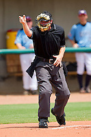 The home plate umpire makes a strike call during the game between AABC and Dixie at the 2011 Tournament of Stars at the USA Baseball National Training Center on June 25, 2011 in Cary, North Carolina.  The AABC defeated Dixie 4-2.  (Brian Westerholt/Four Seam Images)
