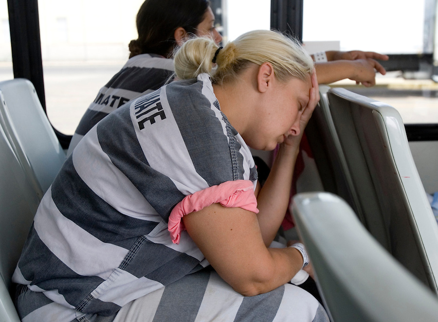 5/16/07- 144418- A member of the female chaing gang rests after a morning of work during the ride back to Estrella Jail. (Pat Shannahan/ The Arizona Republic)