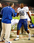 Senior linebacker Sam Maxwell shakes hands with UK Athletic Director Mitch Barnhart after the Cats defeated the University of Georgia Bulldogs 34-27 on Saturday, Nov. 21, 2009 at Sanford Stadium in Athens, Ga.