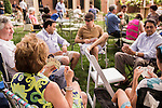 May 8, 2015. Chapel Hill, North Carolina.<br />  Visitors play cards as they wait for the music to start. <br />  On Friday nights between April 24th and October 23rd, the historic Carolina Inn hosts Fridays on the Front Porch with local music, food trucks and drinks on the large front lawn.<br />  Outsiders tend to lump Chapel Hill with nearby Durham, but the more sensible pairing is with Carrboro, the adjacent town that was once a mere offshoot known as West End. Even today the transition from Chapel Hill, anchored by North Carolina''s flagship public university, into downtown Carrboro is virtually seamless.