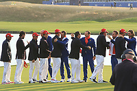 Team USA congratulate Team Europe on the 18th green after Team Europe won the 2018 Ryder Cup at Le Golf National, Ile-de-France, France. 30/09/2018.<br /> Picture Thos Caffrey / Golffile.ie<br /> <br /> All photo usage must carry mandatory copyright credit (© Golffile | Thos Caffrey)