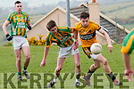 Lios Póil Garreth Ó Nuanain and Listowel Emmets Darragh Leahy in an action during the Junior Club Football Championship match in Lispole on Sunday afternoon.