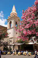 Cafe and church of St. Guiseppe on the Plaza ix Aprile with trees in blossom - Taormina, Sicily