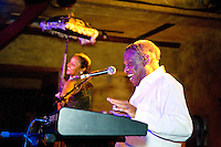 Little Willie Littlefield performs at the 8th annual Ponderosa Stomp, held at the House of Blues in New Orleans on April 28, 2009.  <br /> <br /> Littlefield is a noted boogie woogie piano player from Texas who recorded his biggest hit &quot;It's Midnight&quot; in 1949.  Although never quite recording another big hit Littlefield had a long career, touring extensively in Europe.  <br /> <br /> The Ponderosa Stomp is an annual music festival held in New Orleans since 2002 that celebrates the uncelebrated names in American musical history.  The festival spotlights musicians who have contributed to the American roots musical canon in various genres, from rockabilly to soul to rock and roll to jazz to experimental.  For two nights of the year these mostly forgotten names perform to an audience of aficionados whose memory has not faded and turn back the clock with blistering performances of the hits that did or (in the case of the regional musicians that plugged away unknown to the world at large, as well as those whose songs were recorded to acclaim by other musicians) did not make them famous.  <br /> <br /> In addition to the two nights of performances the Ponderosa Stomp Foundation (the non-profit founded by the eccentric Dr. Ira Padnos and his coterie of like minded music fanatics the Mystic Knights of the Mau Mau) also produces two days of the Music History Conference, where many of the performers, as well as other music industry names, share stories of their lives in the business.  The Conferences take place in the Louisiana State Museum at the Cabildo in Jackson Square.