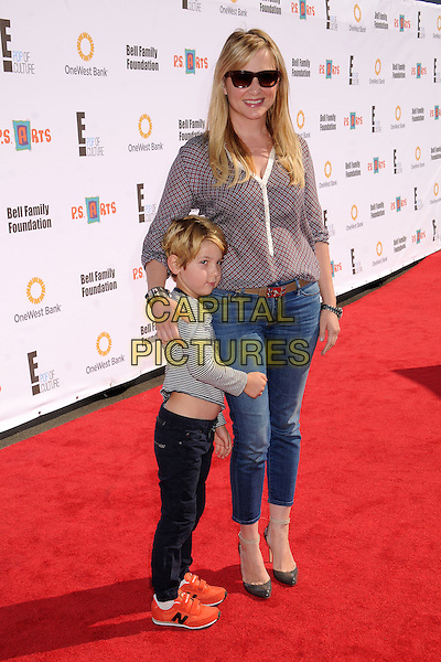 guest & Jessica Capshaw.14th Annual P.S. Arts Express Yourself Family Day held at Barker Hangar, Santa Monica, California, USA..November 11th, 2012.full length top jeans denim boots black sunglasses shades grey gray kid child red blue pattern.CAP/ADM/BP.©Byron Purvis/AdMedia/Capital Pictures.