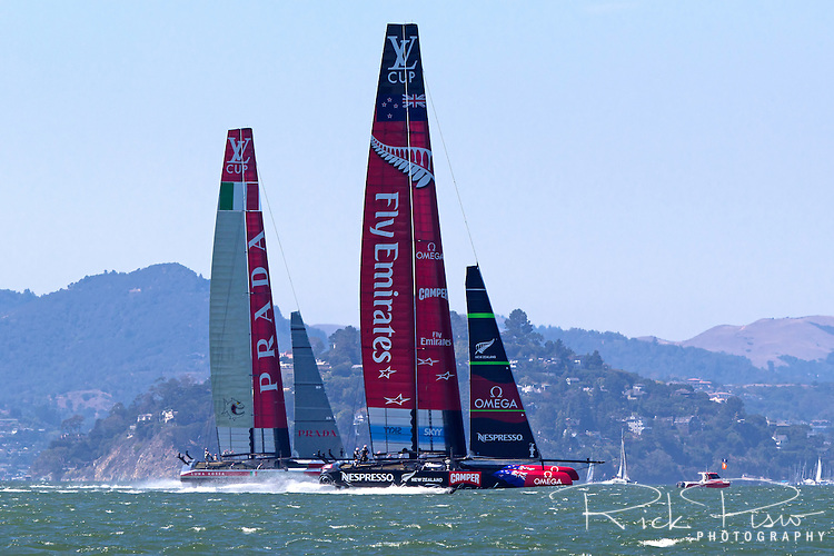 The Luna Rossa Challenge catamaran representing the Circolo della Vela Sicilia in Italy sails against Emirates Team New Zealand, representing the Royal New Zealand Yacht Squadron, on San Francisco Bay during the 2013 Americas Cup competition.