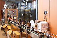Chateau St Jean d'Aumieres, Gignac village. Terrasses de Larzac. Languedoc. Bottling and boxing line. France. Europe.