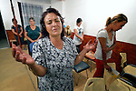 "THIS PHOTO IS AVAILABLE AS A PRINT OR FOR PERSONAL USE. CLICK ON ""ADD TO CART"" TO SEE PRICING OPTIONS.   Katarina Atanazova prays during a worship service in the largely Roma neighborhood of Gorno Ezerovo, part of the Bulgarian city of Burgas. Residents here don't self-identify much as Roma, however, because of the negative connotations associated with the word, so many refer to themselves as a Turkish-speaking minority."