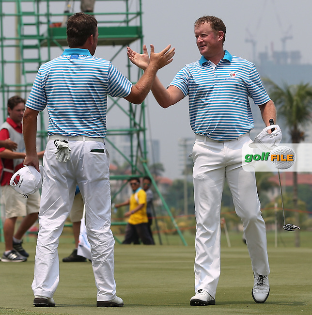 Team Europe's Jamie Donaldson (WAL) and Graeme McDowell (NIR) celebrate winning their Foursome matches 2&1 at the 2014 EurAsia Cup presented by DRB-Hicom, at the Glenmarie Golf & Country Club, Kuala Lumpur, Malaysia. Picture:  David Lloyd / www.golffile.ie