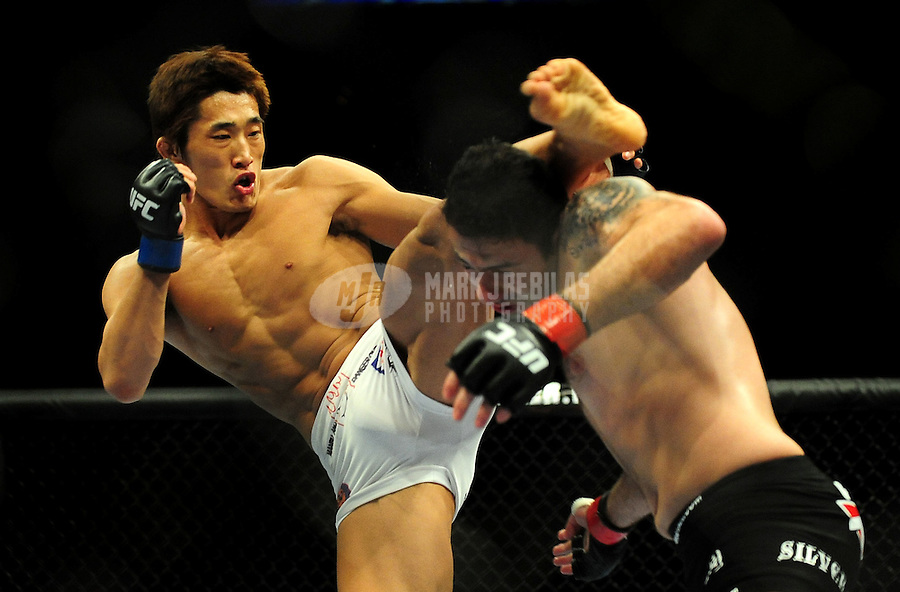 Jan. 31, 2009; Las Vegas, NV, USA; UFC fighter Dong Hyun Kim (white trunks) kicks Karo Parisyan (black trunks) during the welterweight bout in UFC 94 at the MGM Grand Hotel and Casino. Mandatory Credit: Mark J. Rebilas-