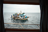 GALAPAGOS ISLANDS, ECUADOR, a fishing boat seen from aboard the M/C Ocean Spray near Tangus Cove