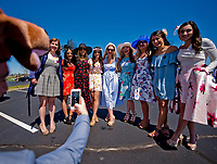 LEXINGTON, KENTUCKY - APRIL 08: A bachelorette party poses for a photo on The Hill on Bluegrass Stakes Day at Keeneland Race Course on April 8, 2017 in Lexington, Kentucky. (Photo by Scott Serio/Eclipse Sportswire/Getty Images)