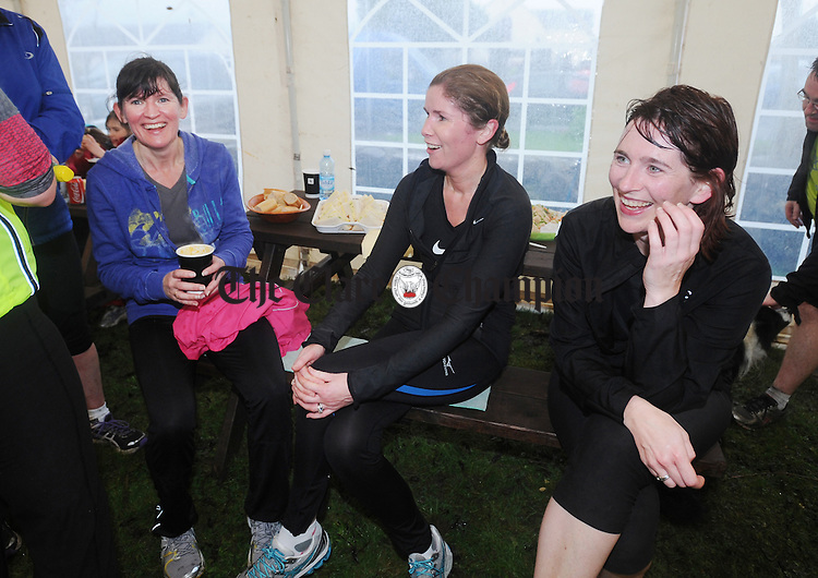 Marian Meaney, Brenda Mc Namara and Maura Corbett relaxing in the marquee at the Shebeen in Doora following the Siúl Linn 10K Charity Walk in support of cancer charities at the weekend. Photograph by Declan Monaghan