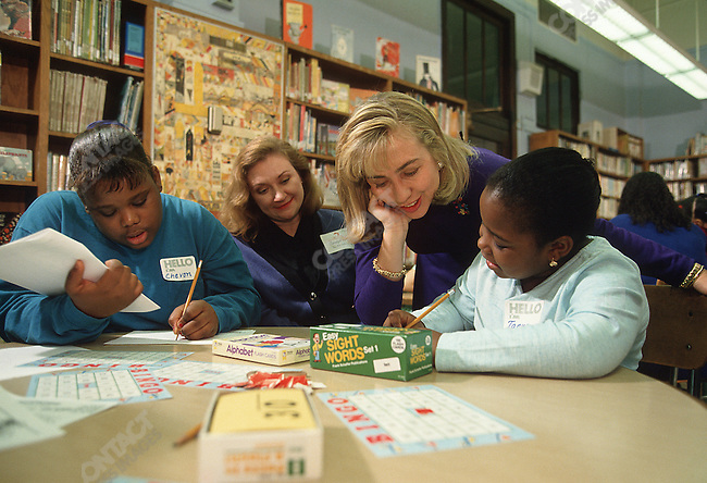 "Hillary Clinton with the ""New York cares"" volunteer tutors program at Alex Humboldt School, New York City, New York, January 1993"