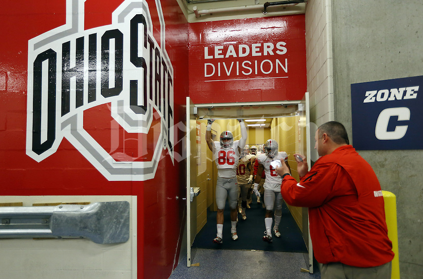 Ohio State football players leave the locker room prior to the first quarter of the Big Ten championship football game against the Michigan State Spartans at Lucas Oil Stadium in Indianapolis on Dec. 7, 2013. (Adam Cairns / The Columbus Dispatch)