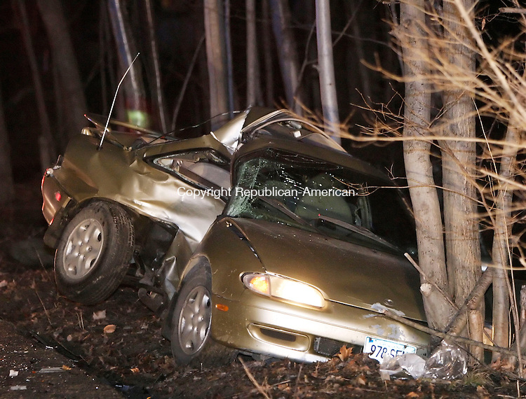 WINSTED, CT. 09 MARCH 2006- 030906BZ07- One of two cars involved in an accident on Mountain Road in Winsted Thursday night came to rest against a tree.<br /> Jamison C. Bazinet Republican-American