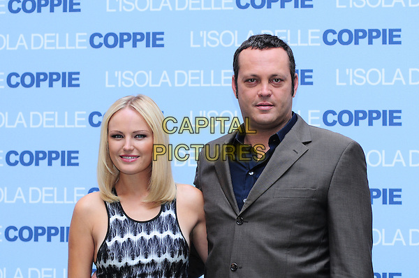 "MALIN AKERMAN & VINCE VAUGHN.Photocall for ""Couples Retreat"", Hassler Hotel, Rome, Italy..October 28th, 2009.half length grey gray suit jacket  ackerman black white sleeveless pattern print .CAP/CAV.©Luca Cavallari/Capital Pictures."
