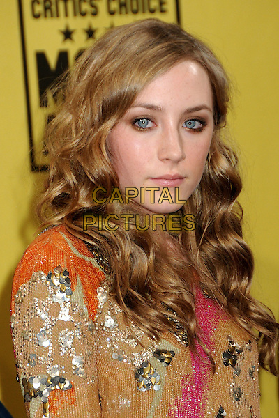 SAOIRSE RONAN.15th Annual Critics' Choice Movie Awards - Arrivals held at the Hollywood Palladium, Hollywood, California, USA, 15th January 2010..portrait headshot wavy hair gold pink orange beige sequin sequined paillettes .CAP/ADM/BP.©Byron Purvis/Admedia/Capital Pictures