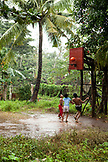 PHILIPPINES, Palawan, Puerto Princesa, Ian, Marvin and Nestor play basketball on Abanico Road in Barangay Village, San Pedro