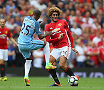 Fernandinho of Manchester City tackles Marouane Fellaini of Manchester United during the Premier League match at Old Trafford Stadium, Manchester. Picture date: September 10th, 2016. Pic Simon Bellis/Sportimage